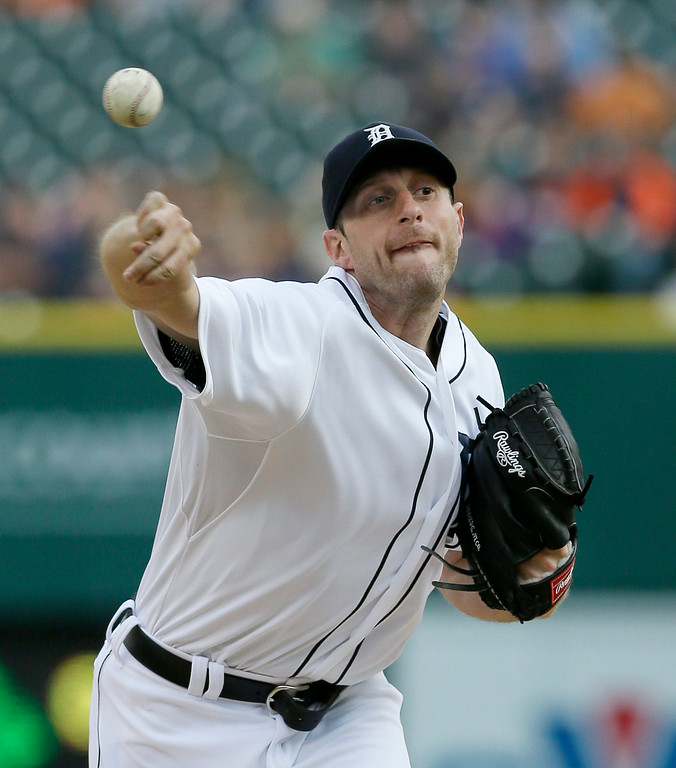 . Detroit Tigers starting pitcher Max Scherzer throws during the first inning of a baseball game against the Chicago White Sox, Wednesday, July 30, 2014 in Detroit. (AP Photo/Carlos Osorio)