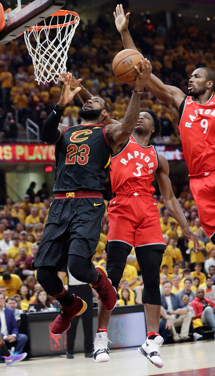 . Cleveland Cavaliers\' LeBron James (23) goes up to shoot against Toronto Raptors\' Serge Ibaka (9), from Republic of Congo, and OG Anunoby (3) in the first half of Game 4 of an NBA basketball second-round playoff series, Monday, May 7, 2018, in Cleveland. (AP Photo/Tony Dejak)