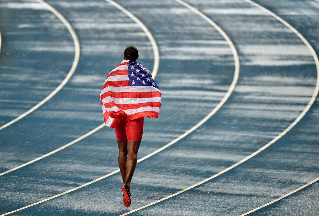 . USA\'s Justin Gatlin celebrates winning silver in the Men\'s 100-meter final at the World Athletics Championships in the Luzhniki stadium in Moscow, Russia, Sunday, Aug. 11, 2013. (AP Photo/Martin Meissner)