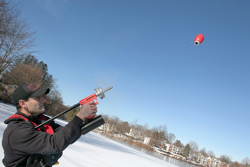 Leominster Fire Department held an ice rescue training on Monday, Dec. 23, 2019 during the warm 50 degree day on Rockwell Pond behind the Senior Center.Trying out the departments line gun is Firefighter Paul Apollanio. The line gun is used to shoot a rope across a river or something similar so they can tie a rope from one side to the other. They did not have a rope attached to the projectile because you can not repack it after it is used. SENTINEL & ENTERPRISE/JOHN LOVE