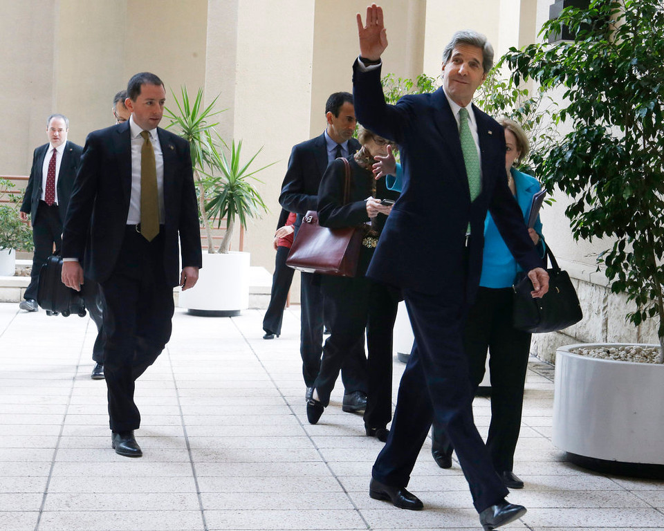 . U.S. Secretary of State John Kerry waves as he arrives for a meeting with members of non-governmental organizations in Cairo, Egypt on Sunday, March 3, 2013. Cairo is the sixth leg of Kerry\'s first official overseas trip and begins the Middle East portion of his nine-day journey. (AP Photo/Jacquelyn Martin, Pool)