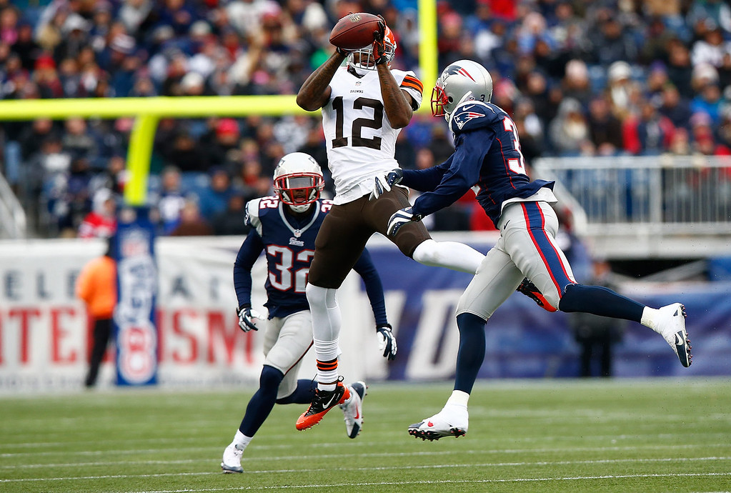. Josh Gordon #12 of the Cleveland Browns catches a pass in front of Aqib Talib #31 of the New England Patriots in the second quarter during the game at Gillette Stadium on December 8, 2013 in Foxboro, Massachusetts.  (Photo by Jared Wickerham/Getty Images)