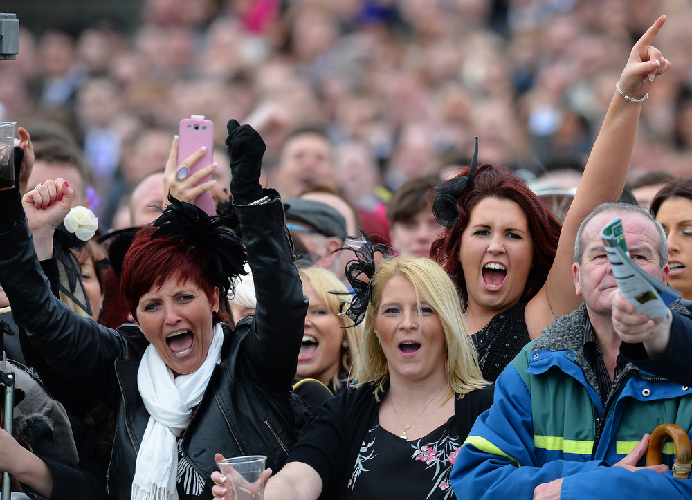 . Ladies cheer during the first race during Ladies Day, the second day of the Grand National Meeting horse racing event at Aintree Racecourse in Liverpool, north-west England on April 5, 2013. The annual three day meeting culminates in the Grand National which is run over a distance of four miles and four furlongs (7,242 metres), and is the biggest betting race in the United Kingdom.  ANDREW YATES/AFP/Getty Images