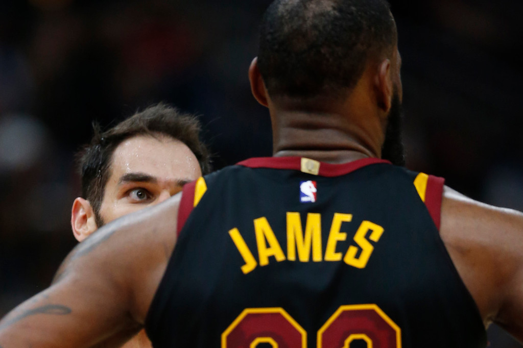 . Cleveland Cavaliers\' Jose Calderon, left, talks to LeBron James during the second half of an NBA basketball game against the Chicago Bulls Monday, Dec. 4, 2017, in Chicago. The Cavaliers won 113-91. (AP Photo/Charles Rex Arbogast)