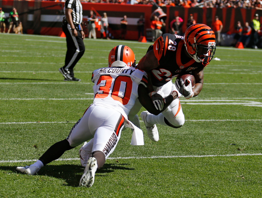 . Cincinnati Bengals running back Joe Mixon (28) runs the ball against Cleveland Browns defensive back Jason McCourty (30) in the first half of an NFL football game, Sunday, Oct. 1, 2017, in Cleveland. (AP Photo/Ron Schwane)