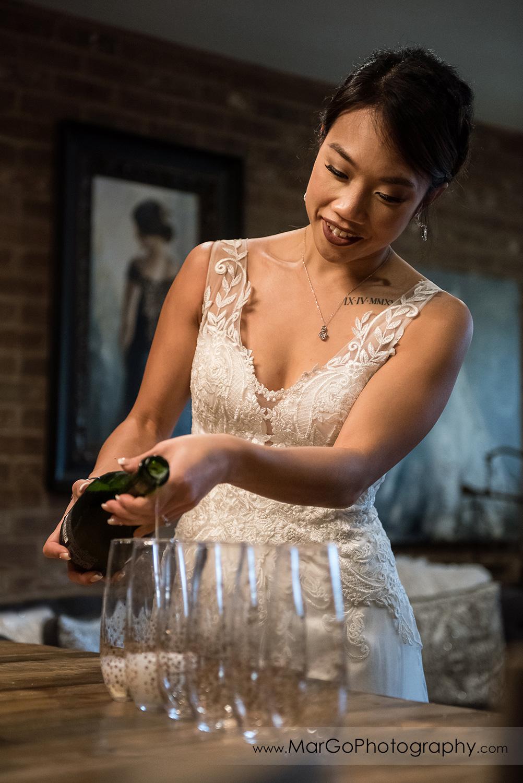 bride purring champagne at Sunol's Casa Bella bridal suite