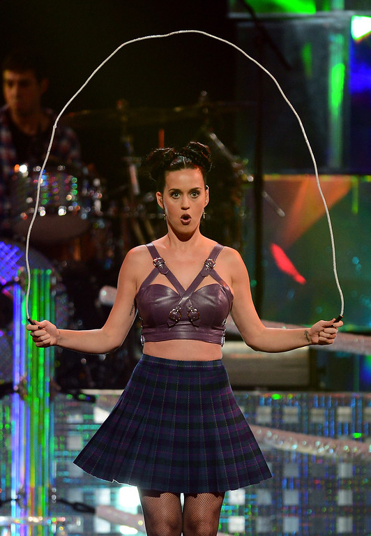. Singer Katy Perry jumps rope as she performs during the iHeartRadio Music Festival at the MGM Grand Garden Arena on September 20, 2013 in Las Vegas, Nevada.  (Photo by Ethan Miller/Getty Images for Clear Channel)