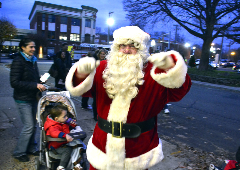 12/4/2015 Mike Orazzi | Staff Santa arrives at Bank of America during Downtown Southington's annual Hospitality Night on Friday night at the town green.