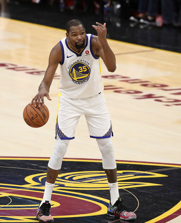 . Golden State Warriors\' Kevin Durant gives instructions in the second half of Game 3 of basketball\'s NBA Finals against the Cleveland Cavaliers, Wednesday, June 6, 2018, in Cleveland. The Warriors defeated the Cavaliers 110-102 to take a 3-0 lead in the series. (AP Photo/Carlos Osorio)