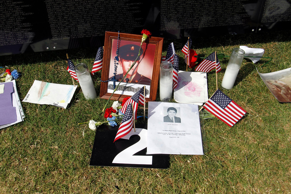 ". Notes and flowers and small United State flags are left under names on the Vietnam Veterans Memorial, during the Vietnam Veterans Memorial ""The Wall That Heals\"" Closing Ceremony event, at La Habra High School, in La Habra, Sunday, July 14, 2013. (SGVN/Correspondent Photo by James Carbone)"