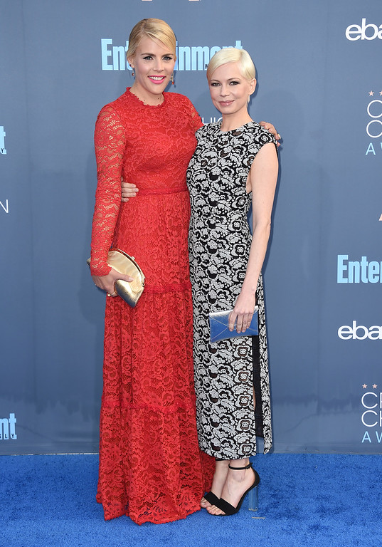 . Busy Philipps, left, and Michelle Williams arrive at the 22nd annual Critics\' Choice Awards at the Barker Hangar on Sunday, Dec. 11, 2016, in Santa Monica, Calif. (Photo by Jordan Strauss/Invision/AP)