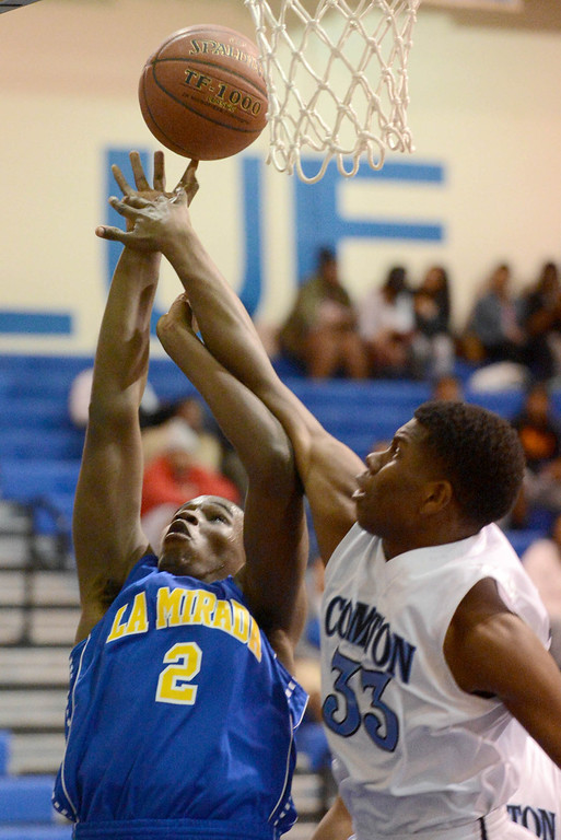 . Compton\'s Tramelle Pritchett (33) tries to block a shot by La Mirada\'s Jarrett Davis (2) in a first round CIF Division 3AAA basketball game Wednesday night in Compton. 20130213 Photo by Steve McCrank / Staff Photographer