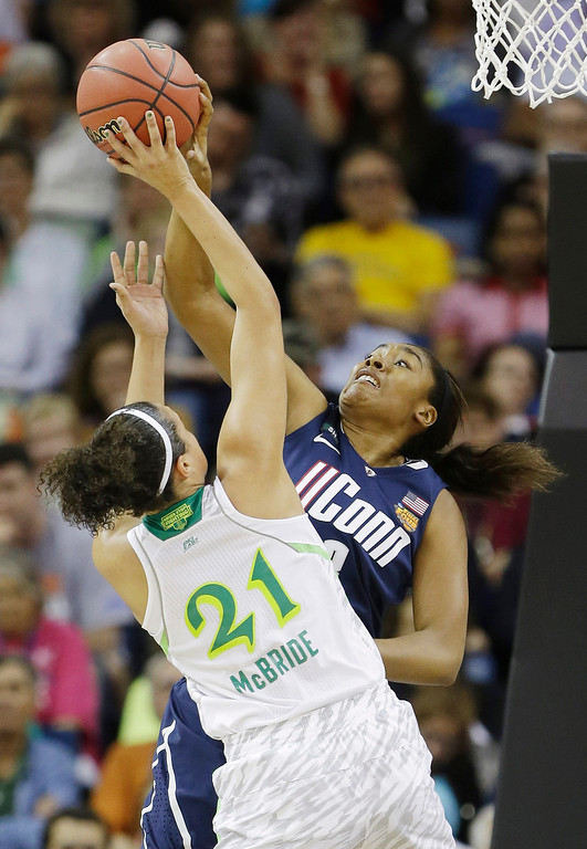 . Connecticut forward Morgan Tuck (3) blocks a shot by Notre Dame guard Kayla McBride (21) in the first half of the women\'s NCAA Final Four college basketball tournament semifinal, Sunday, April 7, 2013, in New Orleans. (AP Photo/Gerald Herbert)