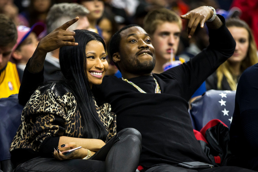 . Nicki Minaj, left, and Meek Mill, right, pose during the second half of an NBA basketball game between the Cleveland Cavaliers and the Philadelphia 76ers, Saturday, Nov. 5, 2016, in Philadelphia. The Cavaliers won 102-101. (AP Photo/Chris Szagola)
