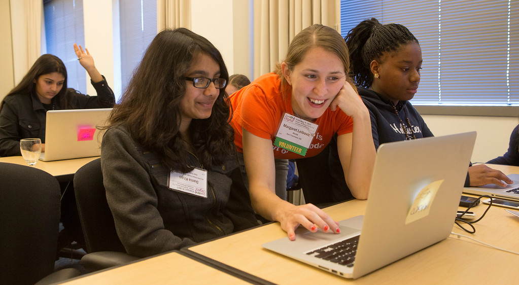 . Volunteer Margaret Leibovic, right, helps Dania Khan, left, of East Palo Alto, during a  mobile gaming app class at the Dare 2B Digital 4th Annual Conference for Young Women at the Oracle Conference Center in Redwood City, Calif. on Saturday, feb. 9, 2013. The conference is for seventh through tenth grade girls and open to anyone. (John Green/Staff)