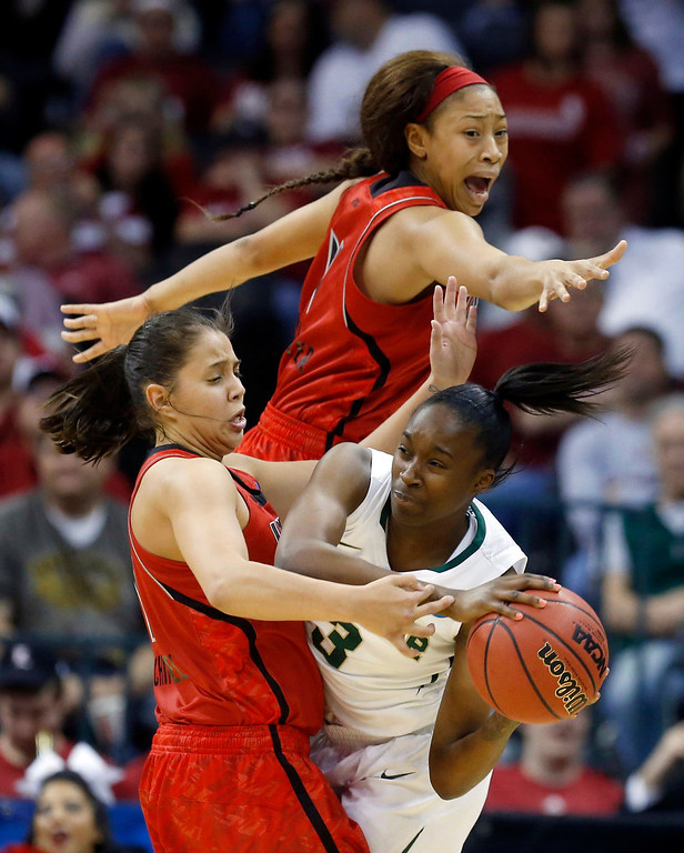 . Louisville guard Shoni Schimmel, left, and guard Antonita Slaughter, top, pressure Baylor guard Jordan Madden (3) as she looks for a teammate to pass to in the first half of a regional semifinal game in the women\'s NCAA college basketball tournament in Oklahoma City, Sunday, March 31, 2013. (AP Photo/Sue Ogrocki)