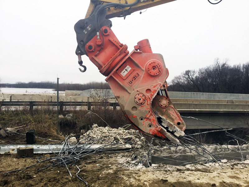NPK U31JR concrete pulverizer on Komatsu excavator-bridge demolition-separating concrete and rebar (2).jpg