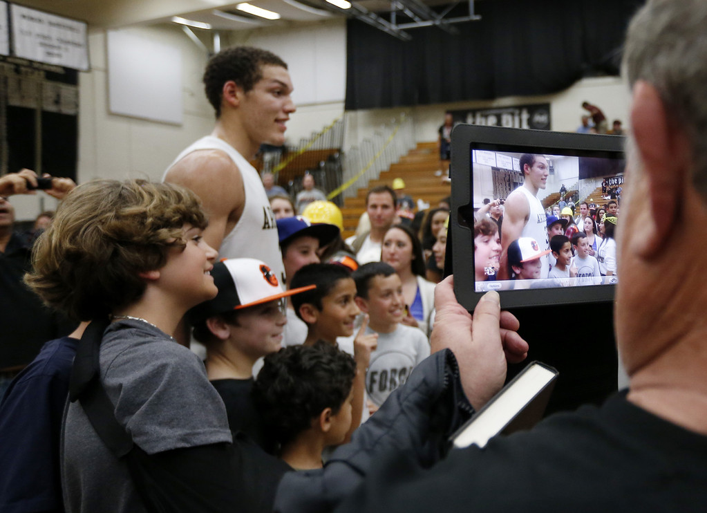 . Archbishop Mitty\'s Aaron Gordon (32) poses with his fans after the 58-54 win against Modesto  at NorCal Boys Open Division semi-finals Varsity Boy\'s Basketball game at Archbishop Mitty High School in San Jose,  Calif., on Tuesday, March 12, 2013.  He is a celebrity at games from kids to teenagers and adults are wanting to be photograph with Aaron Gordon. (Josie Lepe/Staff)