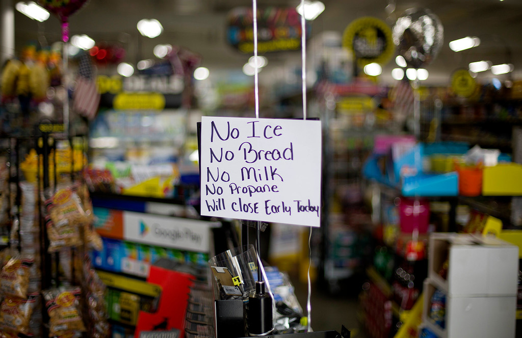 . A message greets shoppers of supplies no longer available as Hurricane Florence approaches the east coast in Nichols, S.C., Thursday, Sept. 13, 2018. . (AP Photo/David Goldman)