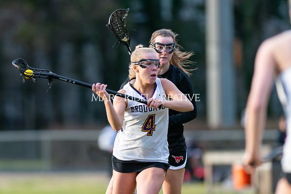 Broughton girls varsity lacrosse vs Middle Creek. February 28, 2020. D4S_0391