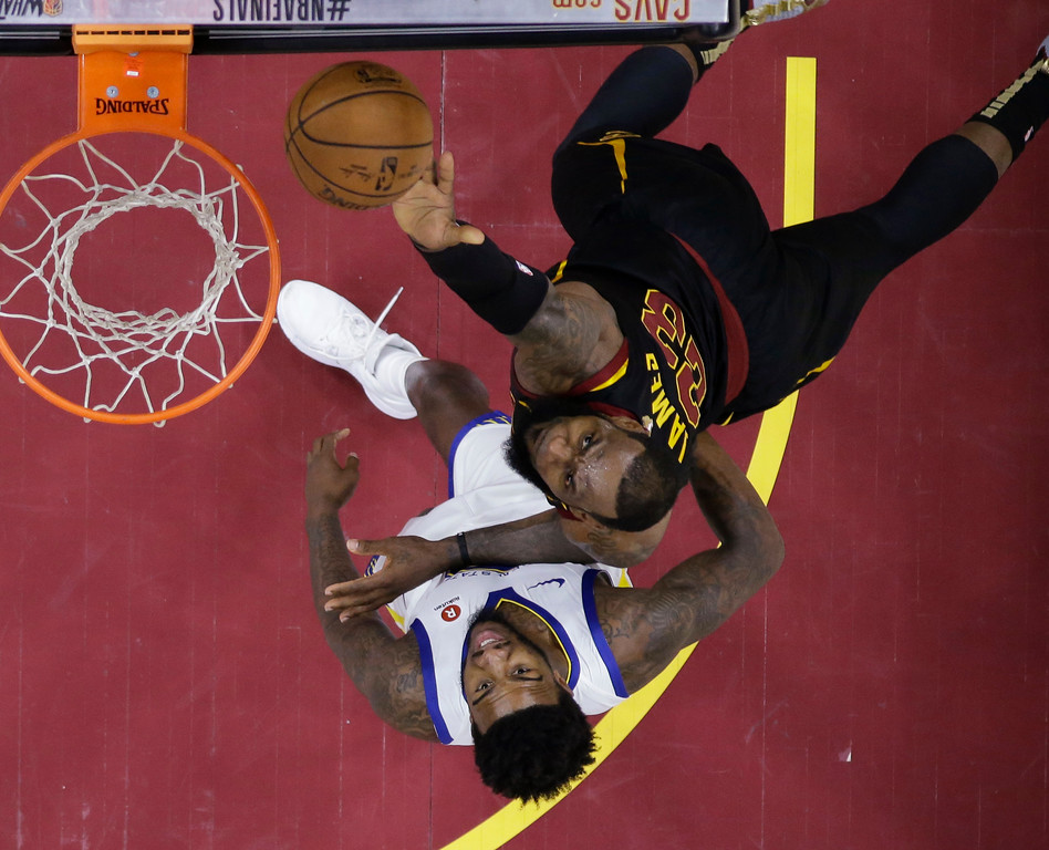 . Cleveland Cavaliers\' LeBron James shoots over Golden State Warriors\' Jordan Bell in the first half of Game 3 of basketball\'s NBA Finals, Wednesday, June 6, 2018, in Cleveland. (AP Photo/Carlos Osorio, Pool)