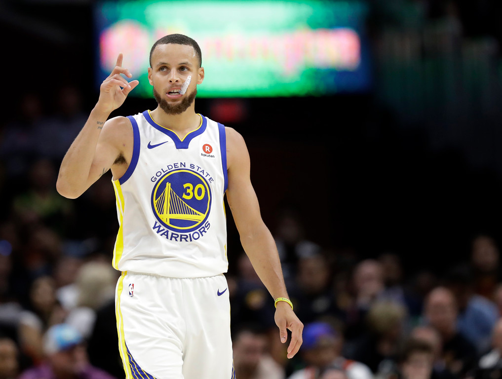 . Golden State Warriors\' Stephen Curry reacts during the second half of Game 3 of basketball\'s NBA Finals against the Cleveland Cavaliers, Wednesday, June 6, 2018, in Cleveland. (AP Photo/Tony Dejak)