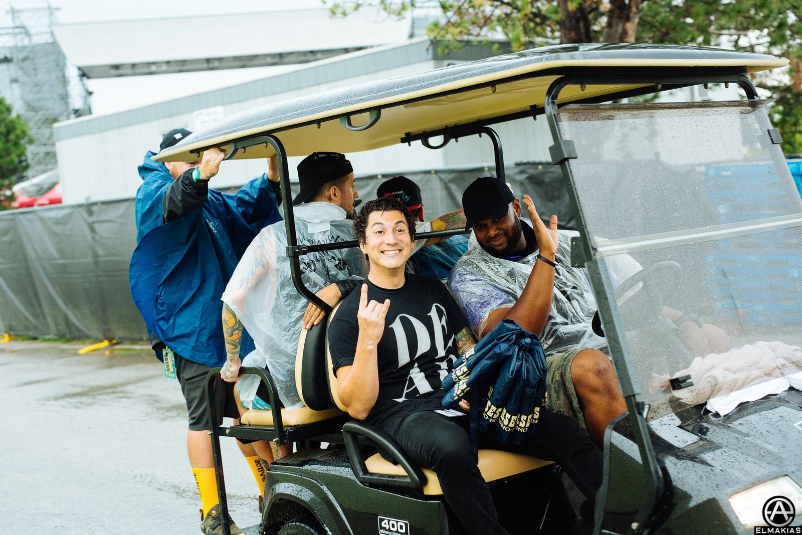 Pierce the Veil in a golf cart at Warped Tour 2015 by Adam Elmakias