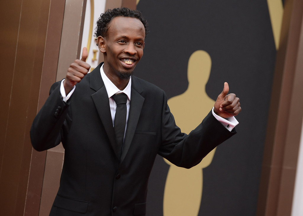 . Barkhad Abdi arrives at the Oscars on Sunday, March 2, 2014, at the Dolby Theatre in Los Angeles.  (Photo by Jordan Strauss/Invision/AP)