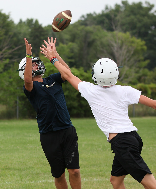 . Randy Meyers - The Morning Journal<br> Asa Kempton makes a catch over a defender during Panther Ball for a score during Elyria Catholic\'s first football practice on July 30.