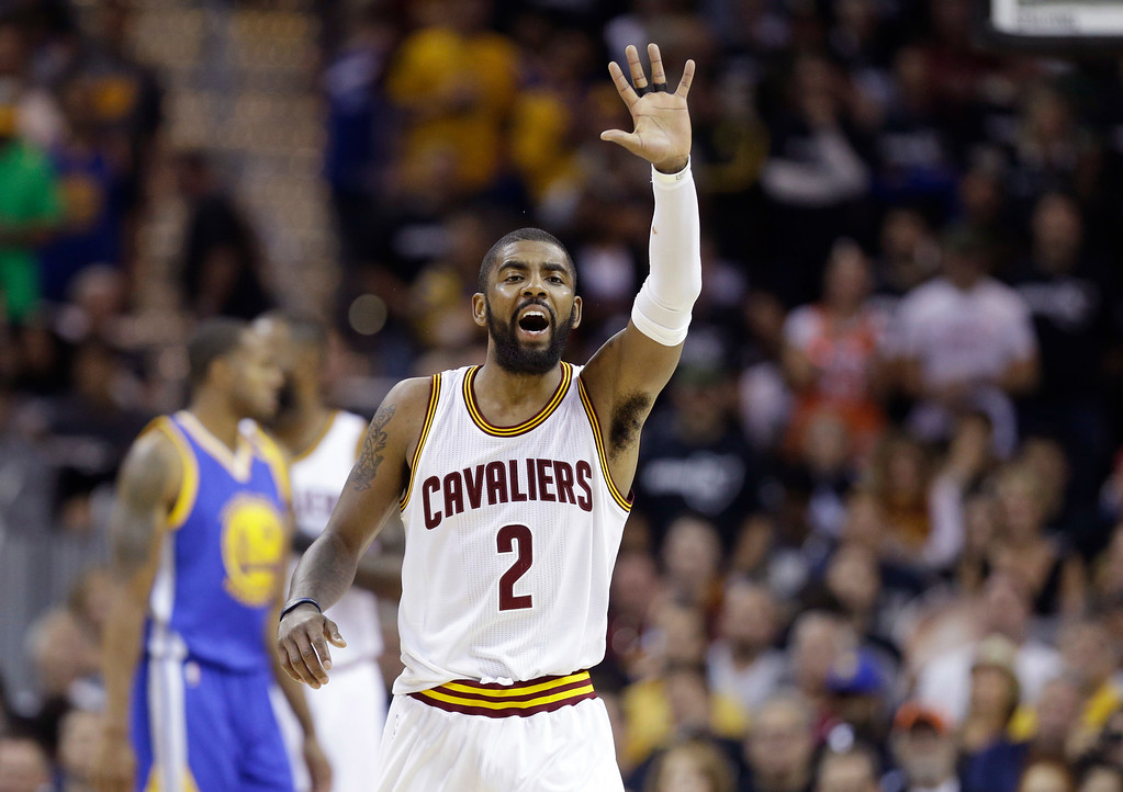 . Cleveland Cavaliers guard Kyrie Irving reacts in the first half against the Cleveland Cavaliers in Game 4 of basketball\'s NBA Finals in Cleveland, Friday, June 9, 2017. (AP Photo/Tony Dejak)