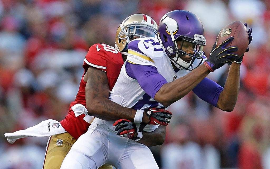 . Vikings wide receiver Jerome Simpson catches a pass in front of 49ers defensive back Perrish Cox during the third quarter. (AP Photo/Marcio Jose Sanchez)