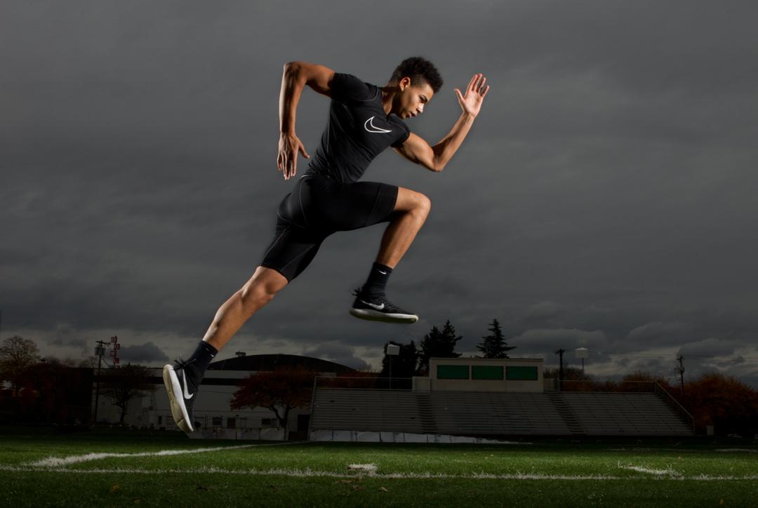 sports model jonny jumping on football field