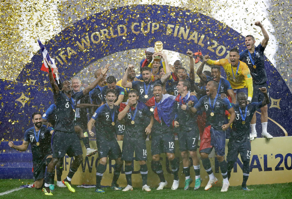 . France goalkeeper Hugo Lloris holds the trophy aloft as he celebrates with his teammates after the final match between France and Croatia at the 2018 soccer World Cup in the Luzhniki Stadium in Moscow, Russia, Sunday, July 15, 2018. France won the final 4-2. (AP Photo/Matthias Schrader)