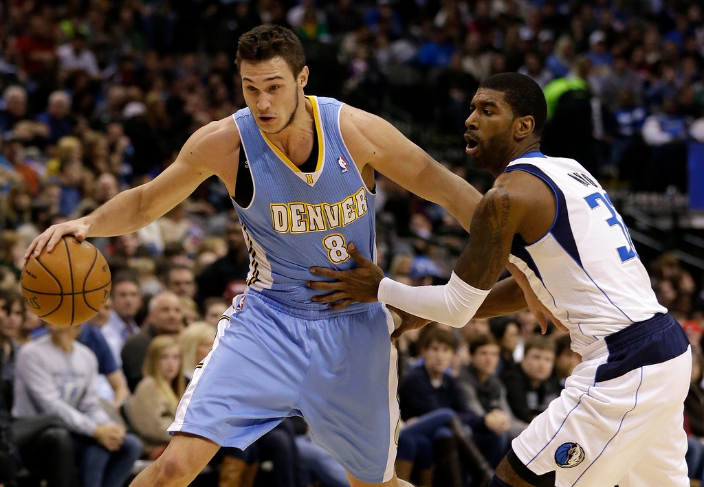 . Denver Nuggets small forward Danilo Gallinari (8), of Italy, gets by Dallas Mavericks\' O.J. Mayo (32) on a drive to the basket in the first half of an NBA basketball game on Friday, Dec. 28, 2012, in Dallas. (AP Photo/Tony Gutierrez)