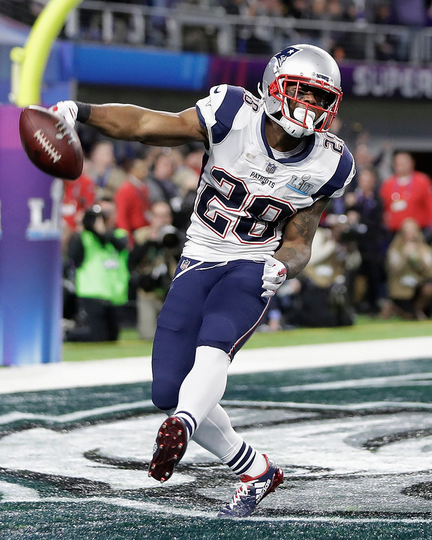 . New England Patriots\' James White celebrates his touchdown run during the first half of the NFL Super Bowl 52 football game against the Philadelphia Eagles Sunday, Feb. 4, 2018, in Minneapolis. (AP Photo/Mark Humphrey)