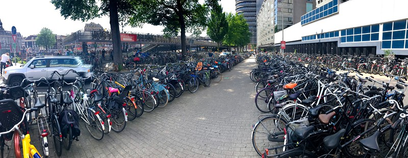 These Dutch are not kidding about riding their bikes!...there is another lot right across the street behind the blue and white tram...and the even a free parking garage for thousands of them! - Amsterdam