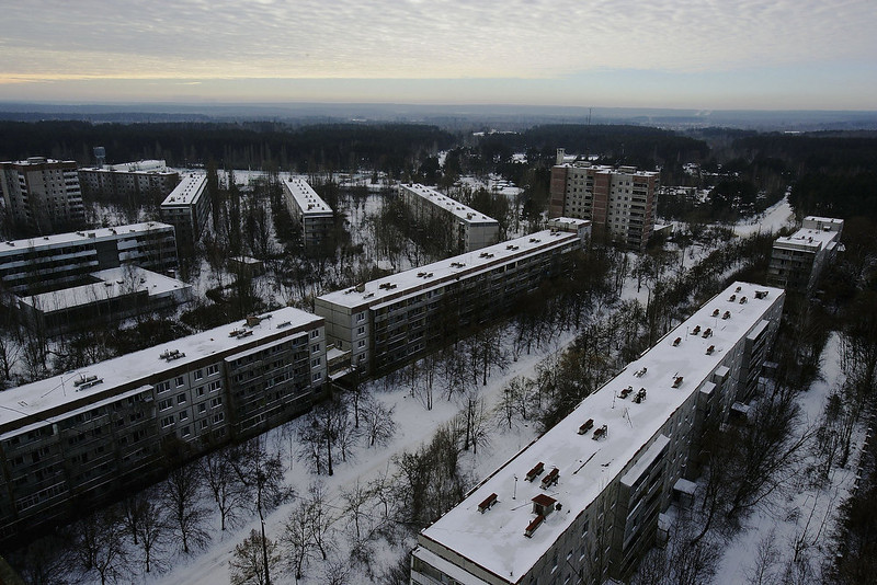 . The abandoned town of Pripyat stretches out into the distance on January 25, 2006 near Chernobyl, Ukraine. The town of Pripyat, deserted since the 1986 catastrophe, once housed 30,000 people, the majority of being workers from the Chernobyl Nuclear Power Plant. Days after the catastrophe the inhabitants were relocated to other locations in the Soviet Union. The town of Pripyat has remained uninhabited since.Prypyat and the surrounding area will not be safe for human habitation for several centuries. Scientists estimate that the most dangerous radioactive elements will take up to 900 years to decay sufficiently to render the area safe.  (Photo by Daniel Berehulak/Getty Images)