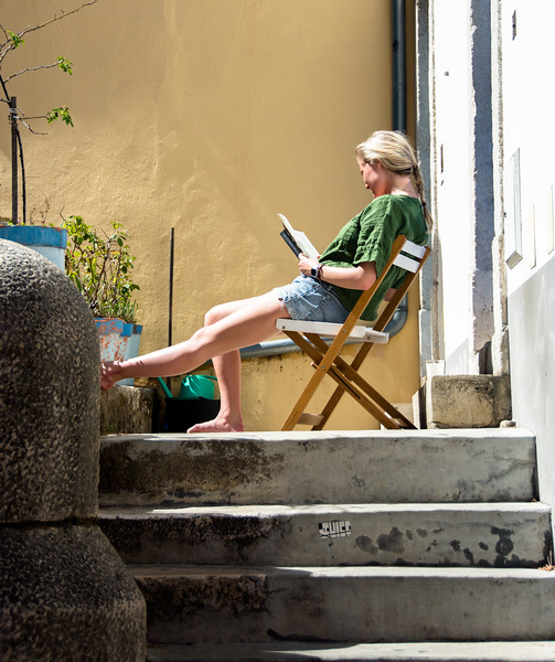 While waiting for Molly at one castle we went to, I saw this girl reading in the sunlight.  The bright light and colors just struck me.