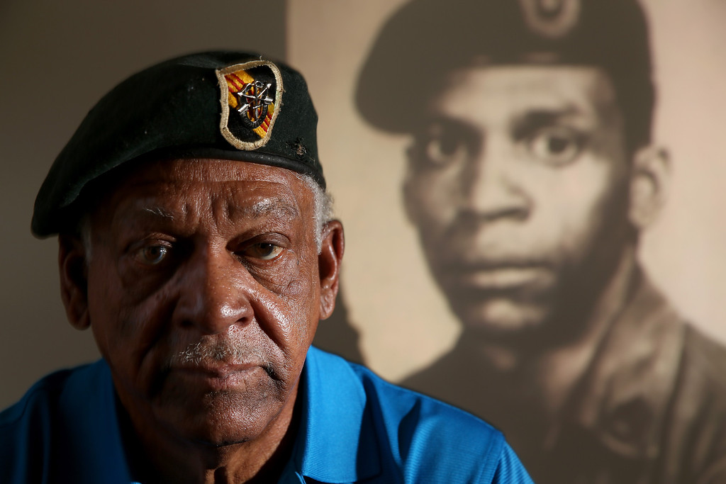 . U.S. Army Staff Sergeant Melvin Morris, a Vietnam War veteran is seen with an image of himself in his uniform projected on the wall behind him at his home on March 04, 2014 in Cocoa, Florida. Melvin Morris and two others are the only living soldiers who will be honored along with 21 others on March 18th, 2014 by President Barack Obama with the Medal of Honor for conspicuous gallantry. Following a congressionally mandated review to ensure that eligible recipients were not bypassed due to prejudice the veterans will receive the Medal of Honor for action during major combat operations in World War II, the Korean War and the Vietnam War.  (Photo by Joe Raedle/Getty Images)