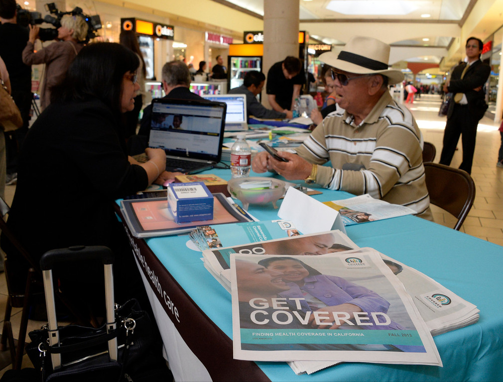 . A man talks to a enrollment counselor at the Panorama Mall in Panorama City, Calif., on Friday, March 28, 2014 regarding health care plans available through Covered California, a state health care exchange. Monday, March 31, is the deadline to enroll for this year. (Photo by Gene Blevins/Los Angeles Daily News)