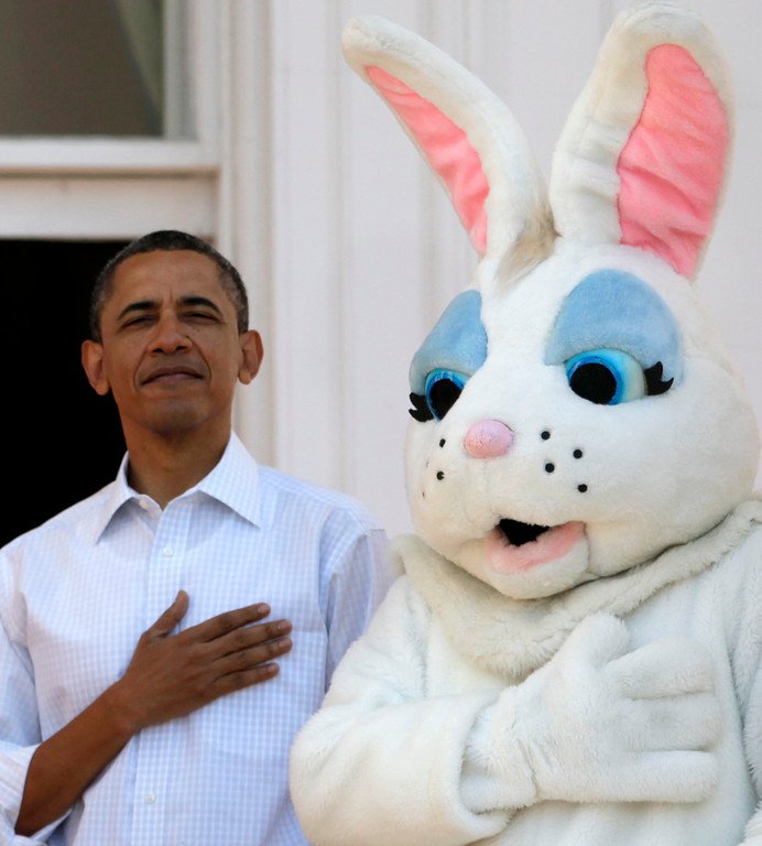 . President Barack Obama stands next to the Easter Bunny during the singing of the National Anthem, at the White House in Washington, Monday, April 9, 2012, during the annual Easter Egg Roll. (AP Photo/Carolyn Kaster)