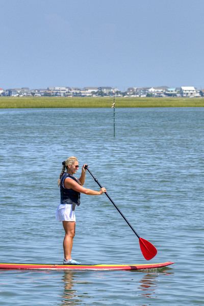 A woman paddleboards along the inlet in Murrells Inlet, SC on Tuesday, September 10, 2013. Copyright 2013 Jason Barnette