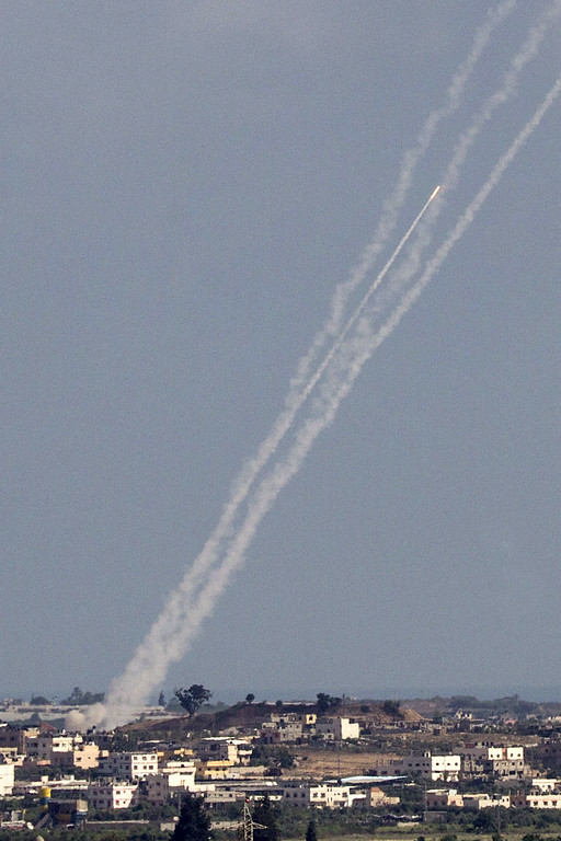 . A picture taken from the Israeli border with the Gaza Strip shows rockets being launched from Gaza towards Israel on July 16, 2014. New Israeli air and tank strikes in Gaza killed several people today, medics said, bringing the death toll from Israel\'s operation in the besieged Palestinian territory to 205. Since the latest violence began before dawn on July 8, 990 rockets fired from Gaza have struck Israel, and another 244 have been shot down by the Iron Dome anti-missile system, army figures show.  AFP PHOTO / JACK GUEZ/AFP/Getty Images