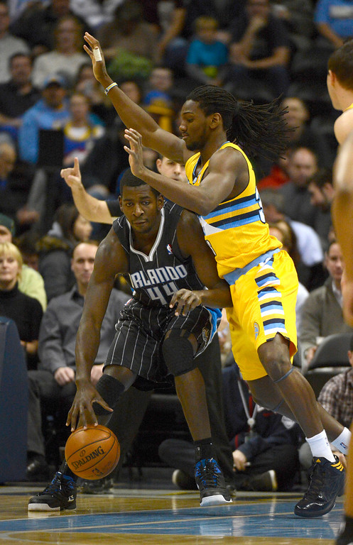 . Denver Nuggets small forward Kenneth Faried (35) plays tough defense on Orlando Magic power forward Andrew Nicholson (44) during the first quarter Wednesday, January 9, 2013 at Pepsi Center. John Leyba, The Denver Post