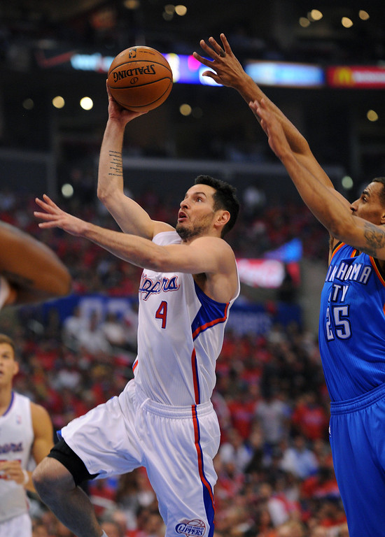 . The Clippers\' J.J. Redick goes to the basket against the Thunders\' Thabo Sefolosha in game six of the Western Conference semifinals, Thursday, May 15, 2014, at Staples Center. (Photo by Michael Owen Baker/Los Angeles Daily News)