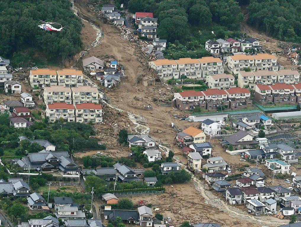 . This aerial view shows the damage caused by a landslide after heavy rains hit the city of Hiroshima, western Japan, on August 20, 2014.  AFP PHOTO / Jiji PressJIJI PRESS/AFP/Getty Images