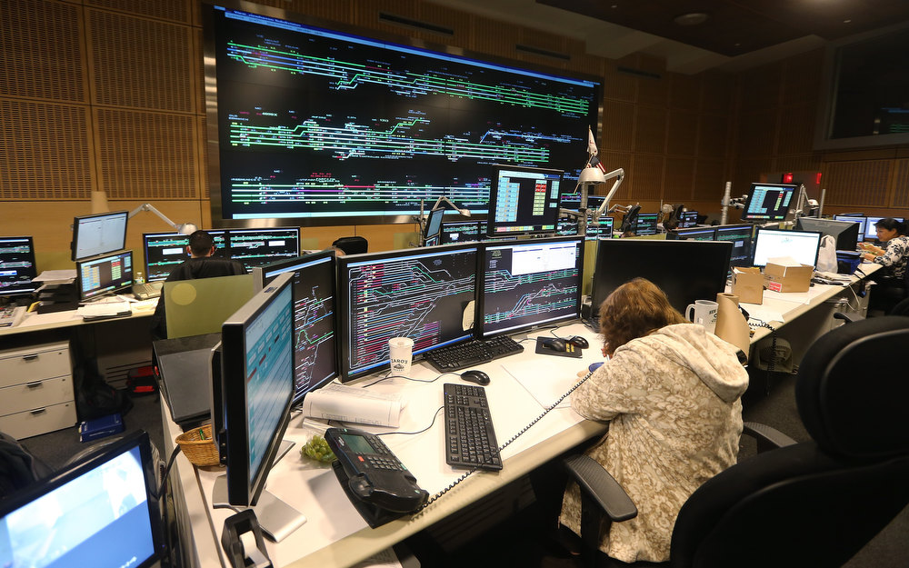 . People work in Metro-North Railroad\'s Operations Control Center at Grand Central Terminal on the day before the famed Manhattan transit hub turns 100 years old on January 31, 2013 in New York City. The terminal opened in 1913 and is the world\'s largest terminal covering 49 acres with 33 miles of track. Each day 700,000 people pass through the terminal where Metro-North Railroad operates 700 trains per day.  (Photo by Mario Tama/Getty Images)