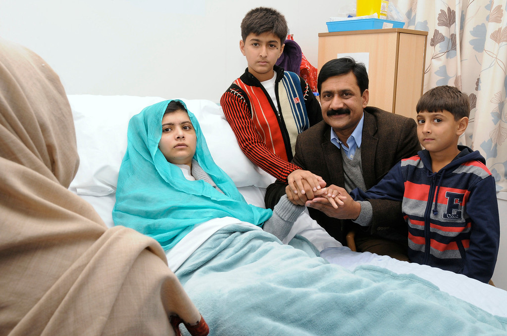 ". Malala Yousufzai is seen with her father Ziauddin and her two younger brothers Khushal Khan and Atal Khan (R), as she recuperates at the The Queen Elizabeth Hospital in Birmingham, in this photograph taken October 25, 2012 and released October 26, 2012. The father of a Pakistani girl who was shot in the head by the the Taliban for advocating girls\' education said on Friday his daughter was strong and would ""rise again\"" to pursue her dreams after receiving treatment in a British hospital. REUTERS/Queen Elizabeth Hospital Birmingham/Handout"