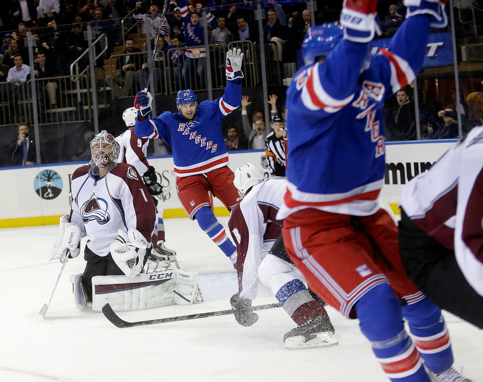 . Colorado Avalanche goalie Semyon Varlamov (1), of Russia,reacts as New York Rangers\' Rick Nash and Derek Stepan, right, celebrate a goal by Stepan during the second period of an NHL hockey game Thursday, Nov. 13, 2014. (AP Photo/Frank Franklin II)