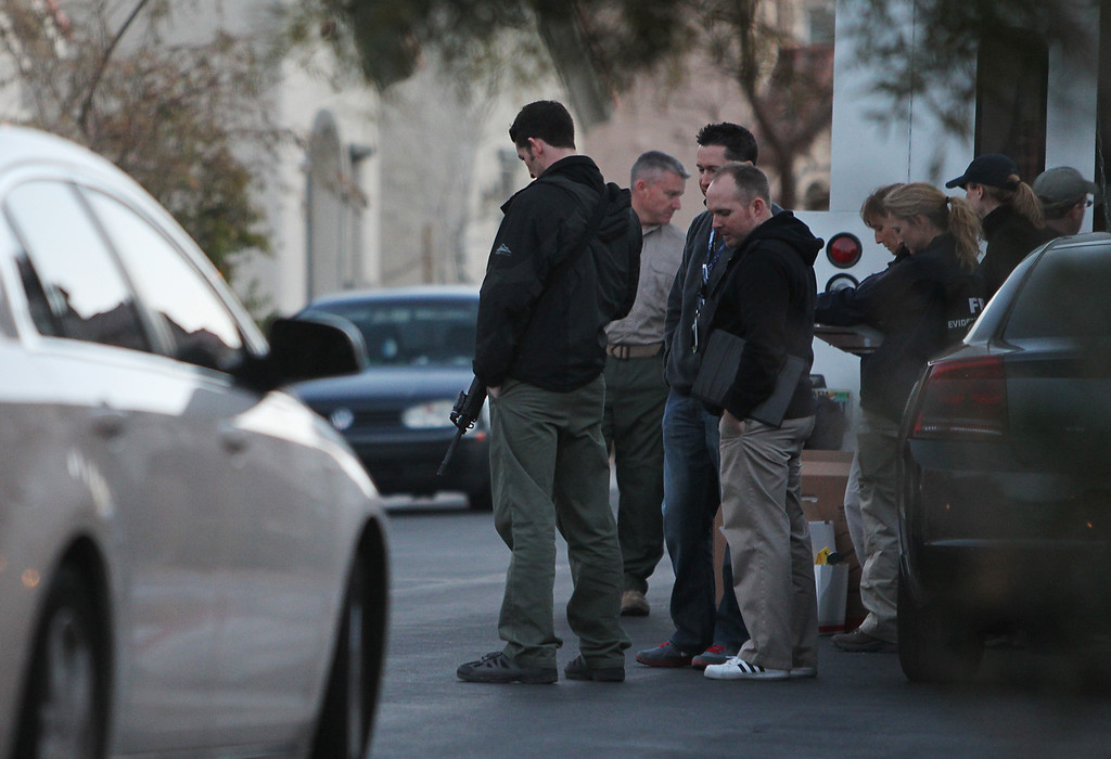 . FBI agents gather in front of the Las Vegas home owned by Christopher Jordan Dorner on Thursday, Feb. 7, 2013. Two Riverside police officers were shot early Thursday morning, one fatally, with the second in critical condition, both were believed to have been shot in a ambush by ex LAPD officer Christopher Jordan Dorner who is still at large. Dorner is also the suspect in the murder of an Irvine couple on Sunday.  (Jason Bean/Las Vegas Review-Journal)